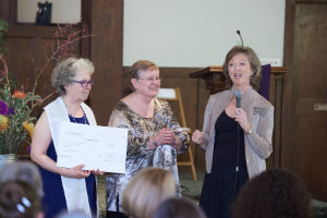 ChI Founder Rev. Gina Rose Halpern, left, holds $80,000 donation from Interfaith Studies' student Mary Lee Dodd, center, with ChI Executive Director Vicki Weiland at the Spring 2017 Ordination and Credentialing Ceremony